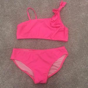 Pink bikini with one shoulder ruffle